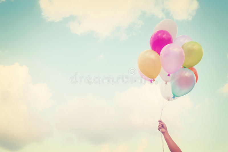 Girl hand holding multicolored balloons royalty free stock photos