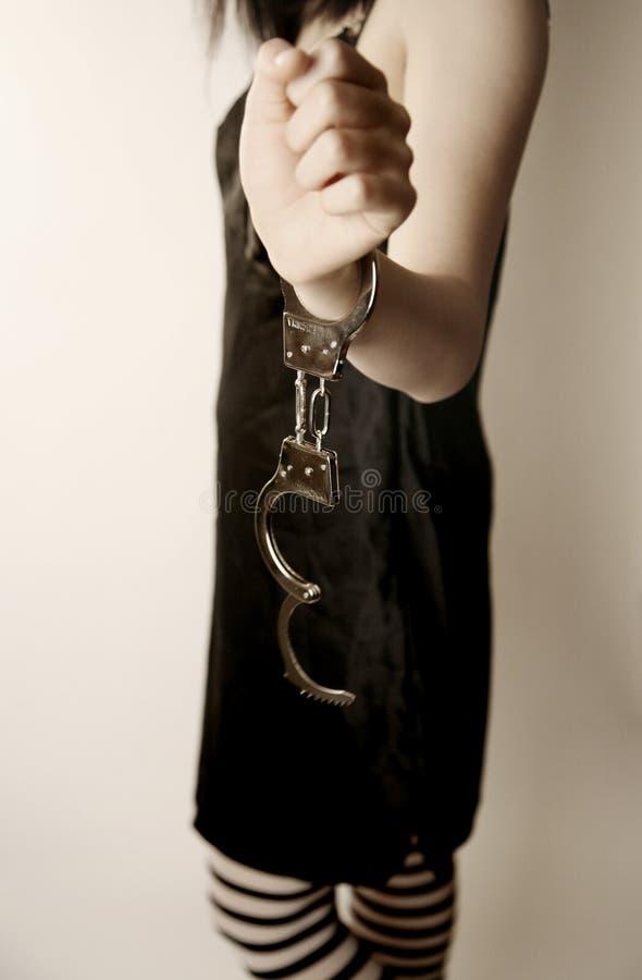 Girl in handcuffs stock photos