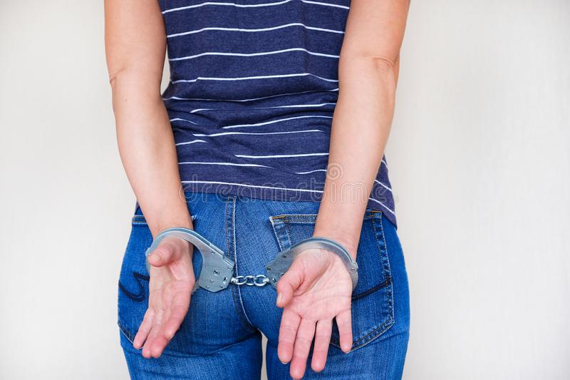 The girl in handcuffs at the police station. Arrested for misdemeanors.  stock images