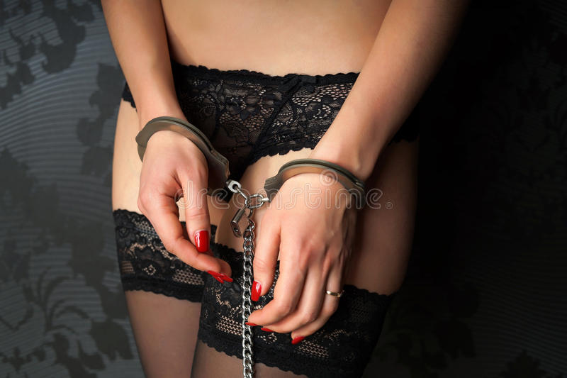 Girl in handcuffs royalty free stock photos