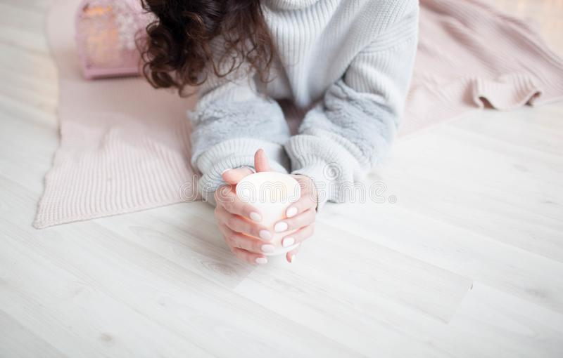 The girl in the hands holding electric candle royalty free stock photo