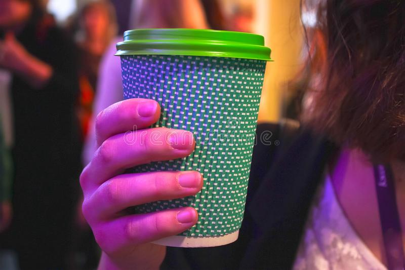 girl hands holding plastic cup of coffee and drinking stock image