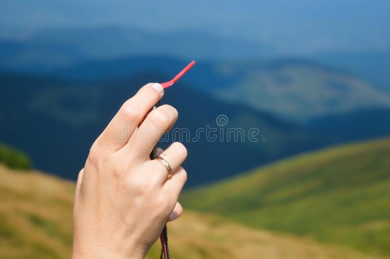 Girl hands while taking photo on way to Hoverla on Carpathian mountains background, Ukraine. stock photography