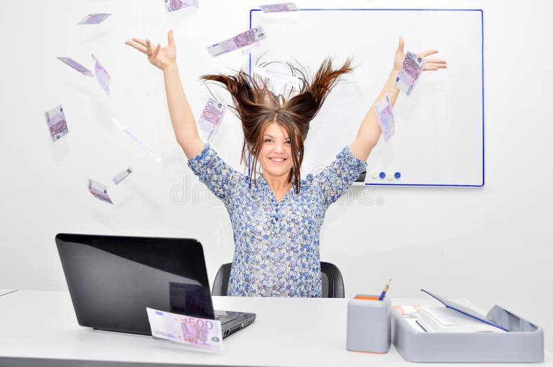 The girl happy brown-haired throws into the air bills 500 euros. Success concept of a young woman. royalty free stock photography