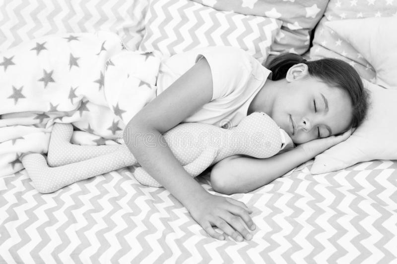 Girl happy child lay bed pillow and blanket bedroom. Lullaby concept. Ways to fall asleep faster. Fall asleep as fast as. Possible. Fall asleep faster and sleep royalty free stock photo