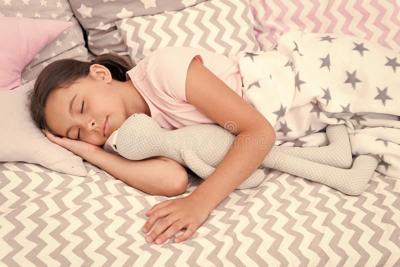 Girl happy child lay bed pillow and blanket bedroom. Lullaby concept. Ways to fall asleep faster. Fall asleep as fast as. Possible. Fall asleep faster and sleep royalty free stock photography