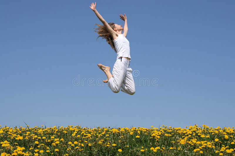 Girl in a happy jump stock photos