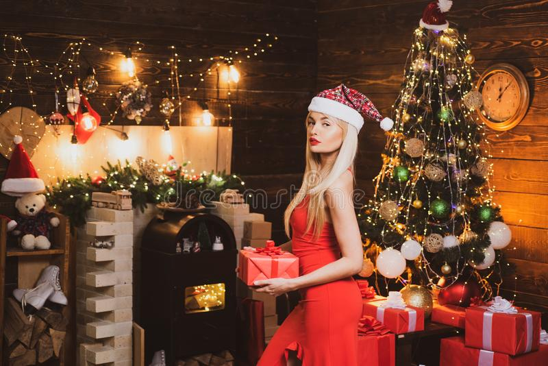 Girl is happy about the new year. Beauty Santa girl. Pretty woman celebrating new year or an event. Beautiful new year. And Christmas scene royalty free stock photos