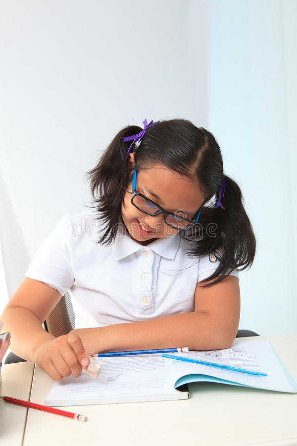 Free Girl Happy To Do Home Work Royalty Free Stock Images - 27320409