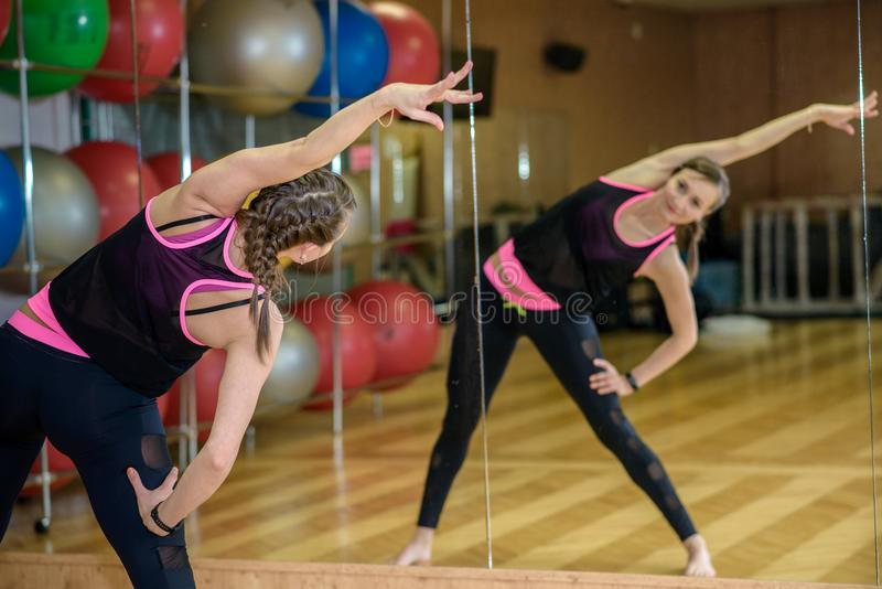 The girl has been stretching in front of the mirror royalty free stock photography