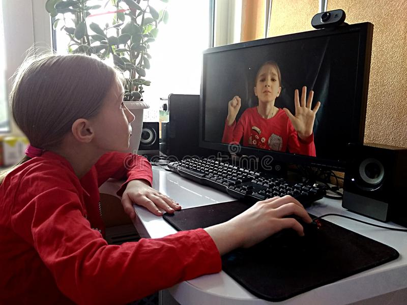 Computer dependence of the child. The girl has a computer addiction, she constantly sits at the computer. The monitor shows a child who is trying to get rid of stock images