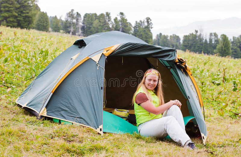 Girl has a rest in green tent royalty free stock images
