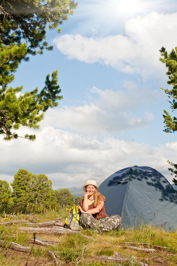 Girl has a rest in green tent royalty free stock photo