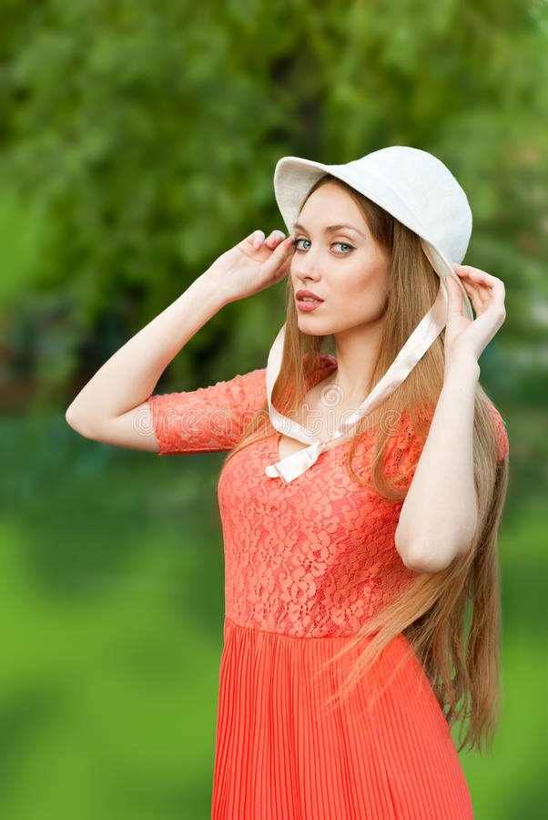 The girl in the hat stock images