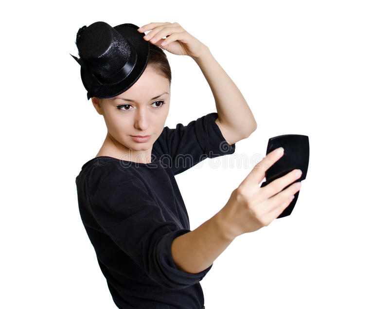 Girl with hat arranging herself stock photo