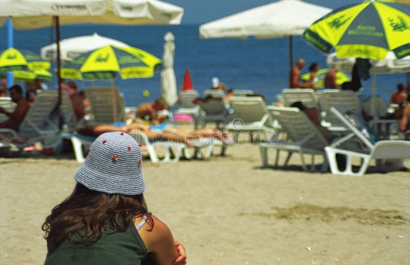 Download Girl with Hat on the Beach stock photo. Image of umbrellas - 1845056