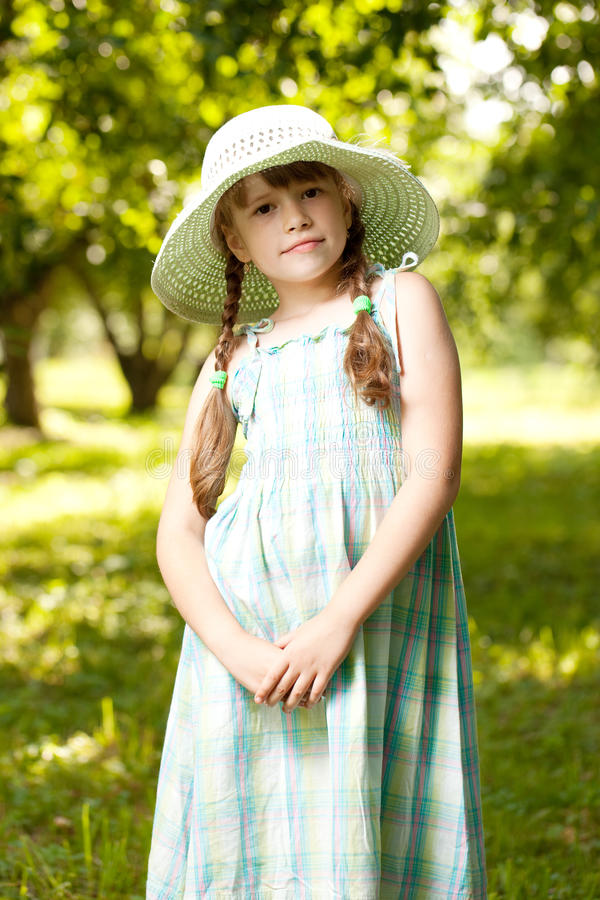 Download Girl in the hat and dress stock photo. Image of beautiful - 26134720