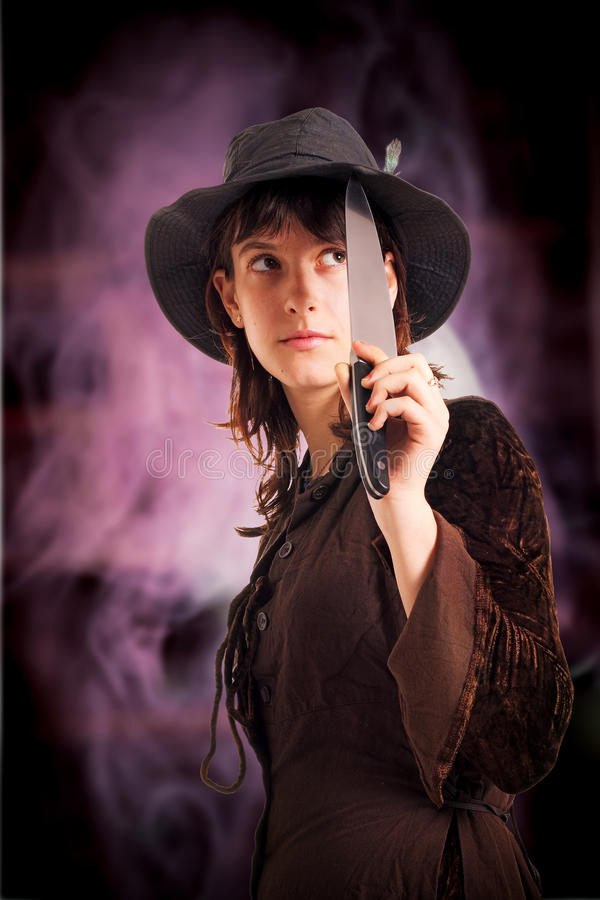 Download Girl In The Hat With The Knife Stock Image - Image: 20207835