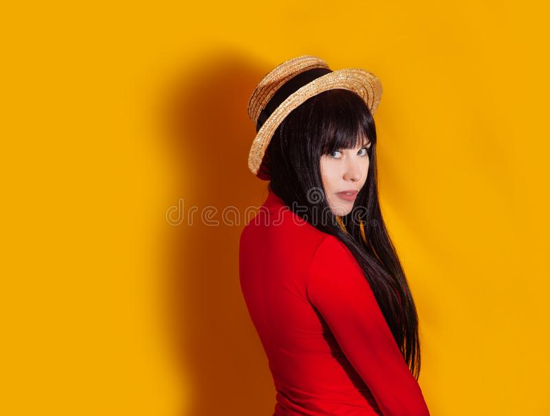 Girl hat sun light shadow tropical yellow orange young woman background red dress tropic royalty free stock photos