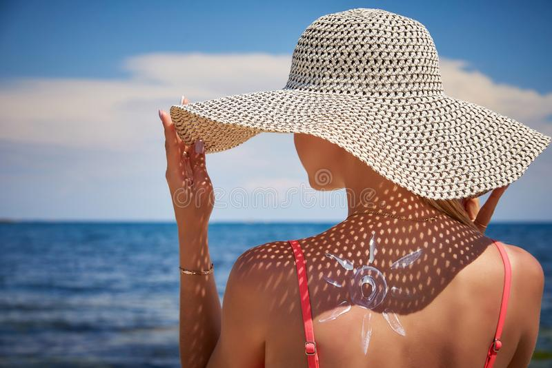 Girl in hat with sunscreen royalty free stock images