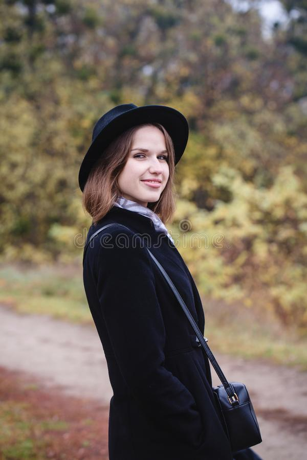 Girl in a hat walking in the park royalty free stock images