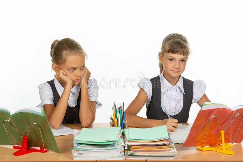 Girl hates looking at a classmate. Girl hates looking at a  classmate royalty free stock photography