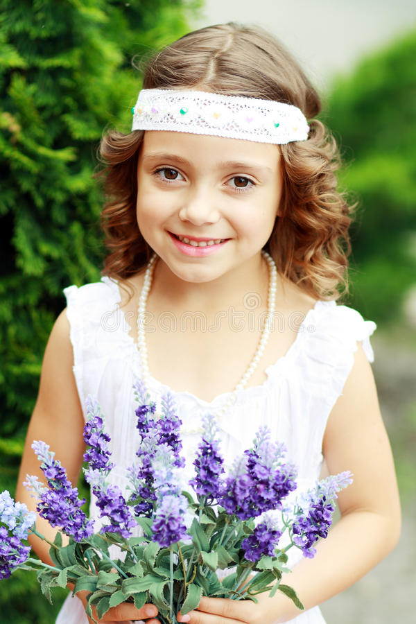 Girl have fun with flowers royalty free stock photos