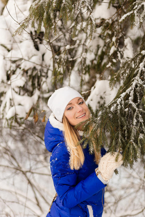 Download The Girl Have A Rest In The Winter Woods. Stock Photo - Image: 83719182