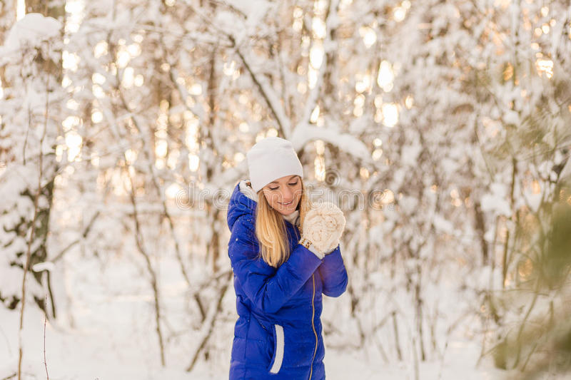 Download The Girl Have A Rest In The Winter Woods. Stock Image - Image: 83720077