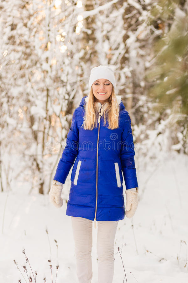 Download The Girl Have A Rest In The Winter Woods. Stock Photo - Image: 83720182