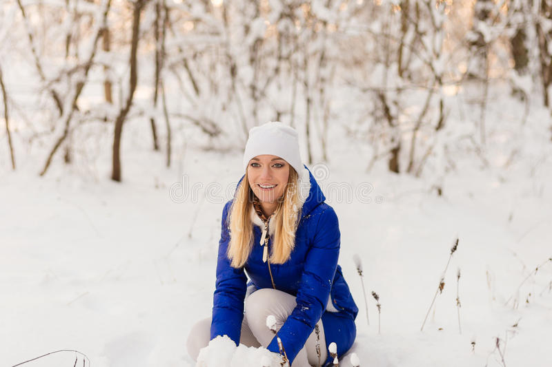 Download The Girl Have A Rest In The Winter Woods. Stock Image - Image: 83721113