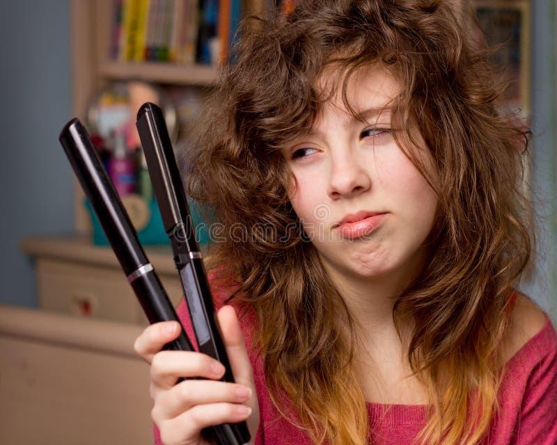 Girl having bad hair day stock photo