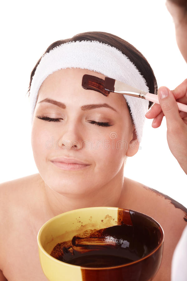 Girl having chocolate facial mask. royalty free stock image