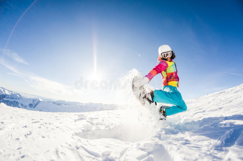 Girl having fun on her snowboard stock photo