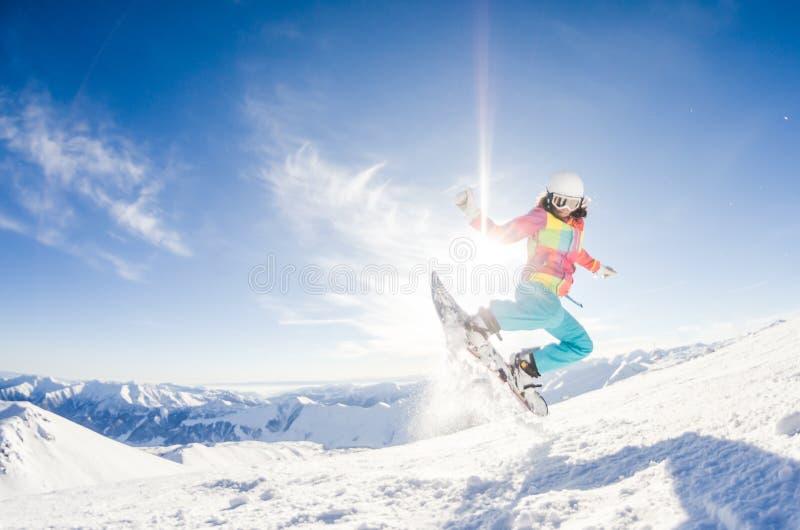 Girl having fun on her snowboard stock photos