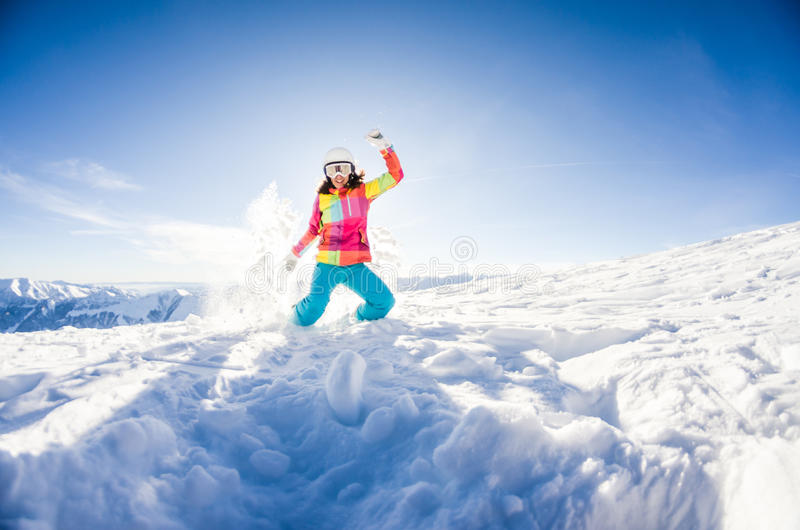 Girl having fun on her snowboard stock images