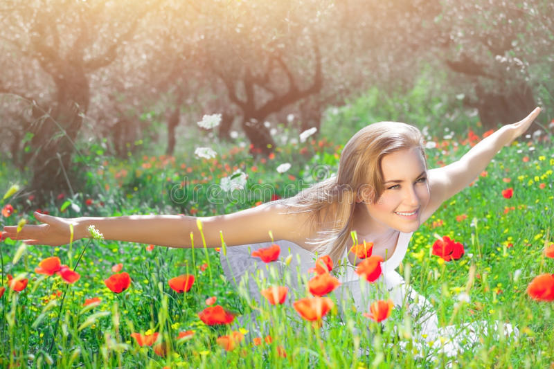 Girl having fun on poppy field stock images