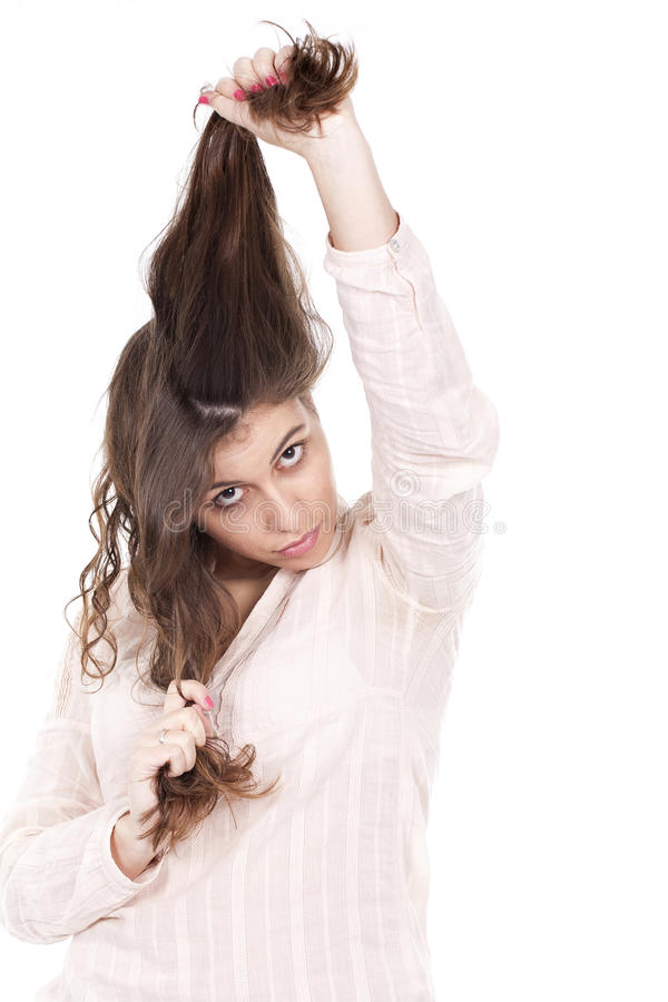 Girl having fun and pulling her long hair