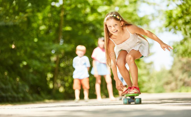 Girl is having fun while skateboarding royalty free stock images