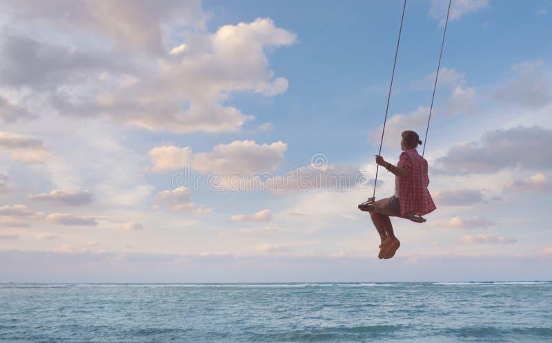 Girl having fun on swing royalty free stock images