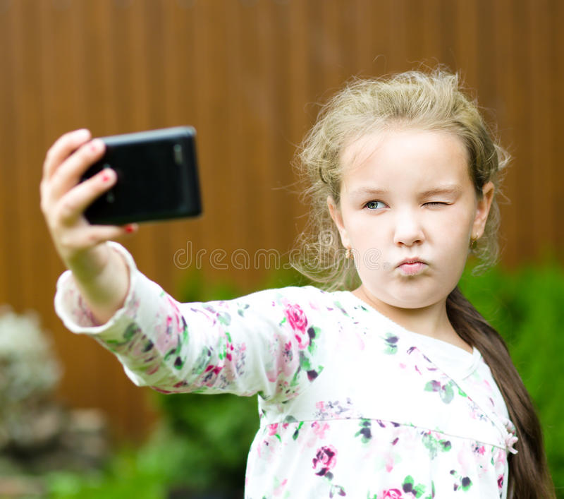 Girl having fun taking selfie royalty free stock photo