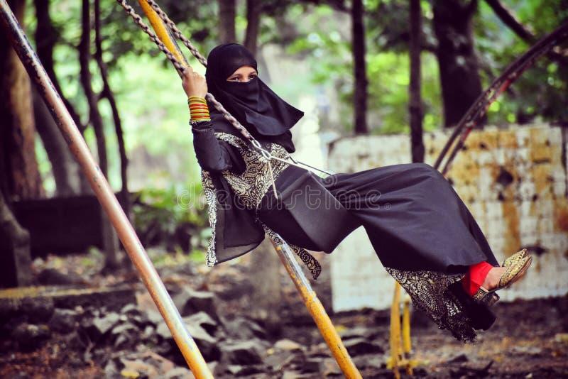 Burkha Girl. A girl having fun While wearing burkha stock images