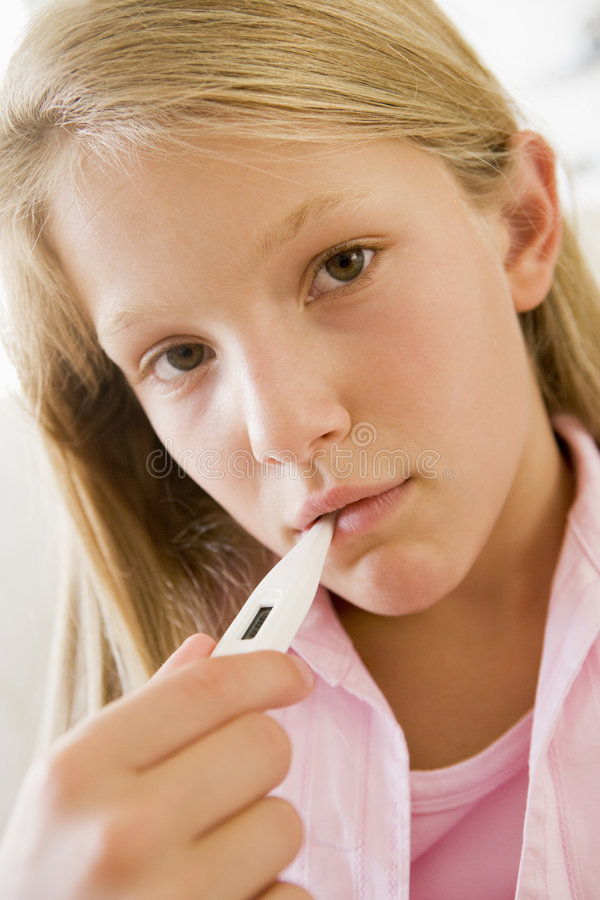 Girl Having Her Temperature Measured royalty free stock photo