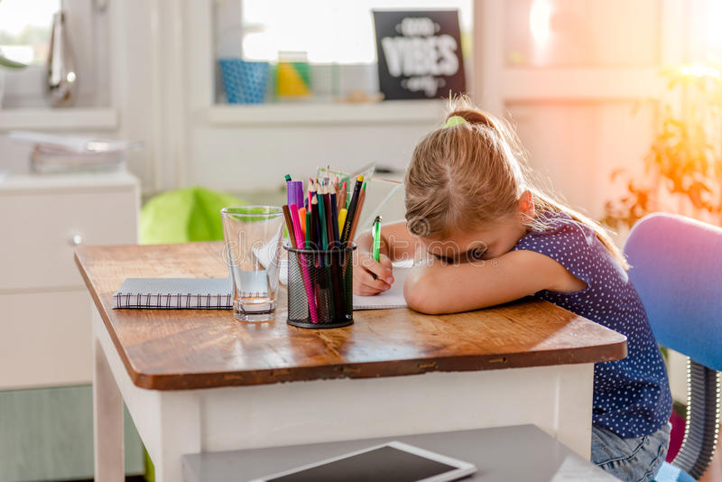 Girl having problem with learning stock photography