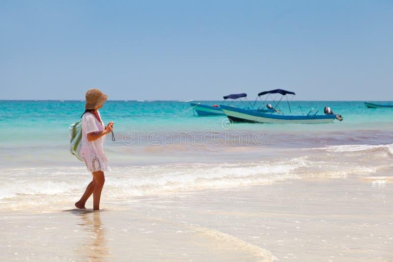 Girl having a walk in Playa Paraiso, Mayan Riviera