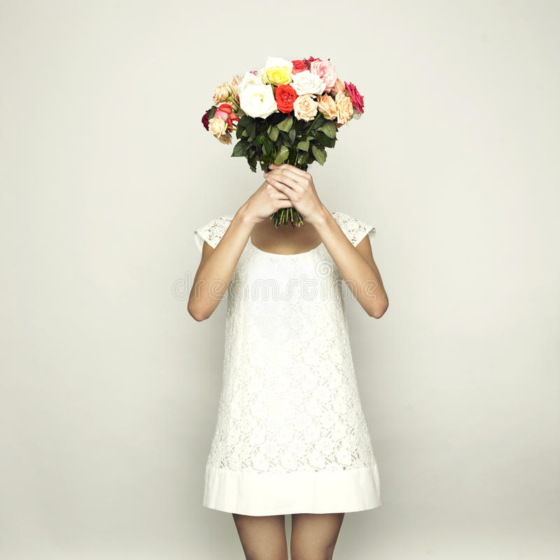 Girl with a head-roses royalty free stock photo