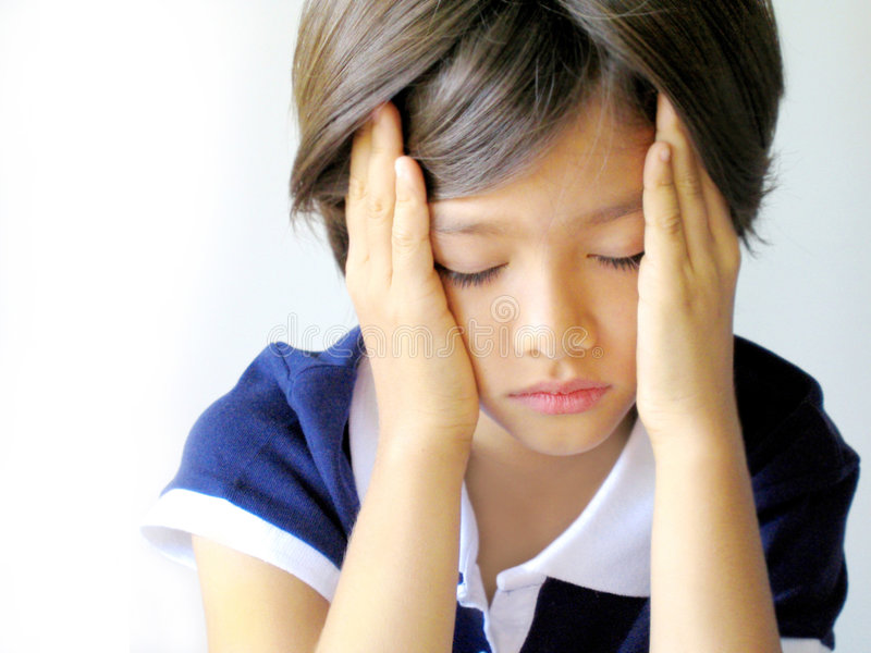 Girl with headache. Profile of a nine year old schoolgirl expressing headache, burnout-syndrom, under stress, tiredness, problems, who-cares attitude, etc. With royalty free stock photography