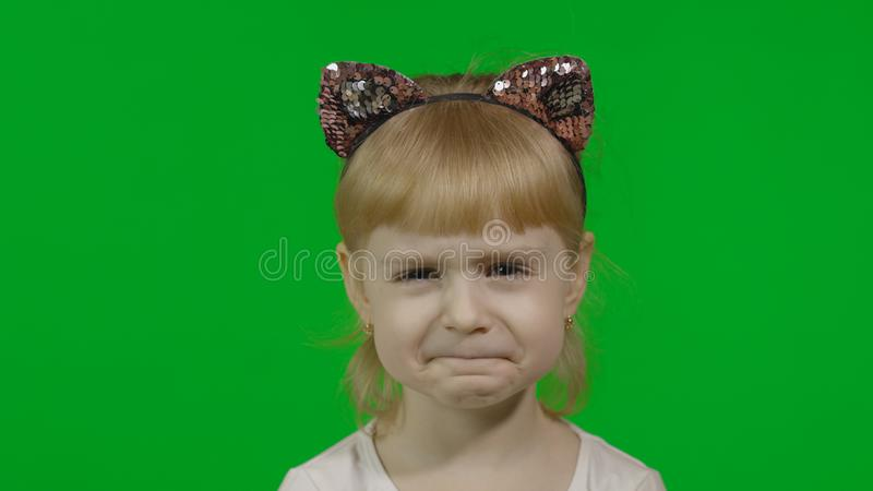 Girl in headband with a cat ears shows emotion of dissatisfied. Chroma Key royalty free stock image