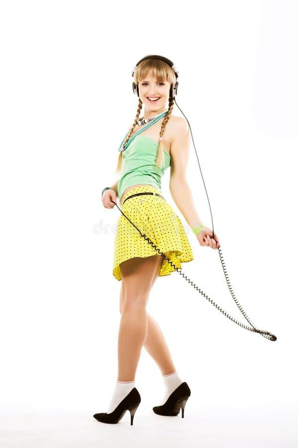 Girl in headphones royalty free stock photo