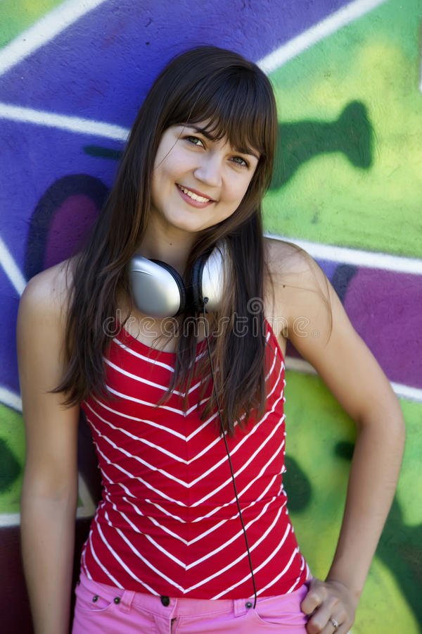 Download Girl With Headphones And Graffiti Wall Stock Image - Image: 20445553